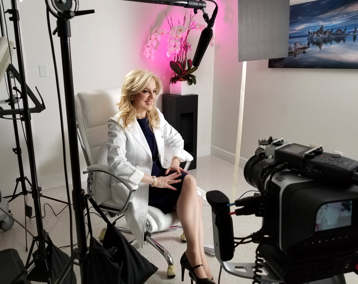 Behind the scenes photo as Dr. Leyda Bowes gets ready to start the filming for her testimonial video.