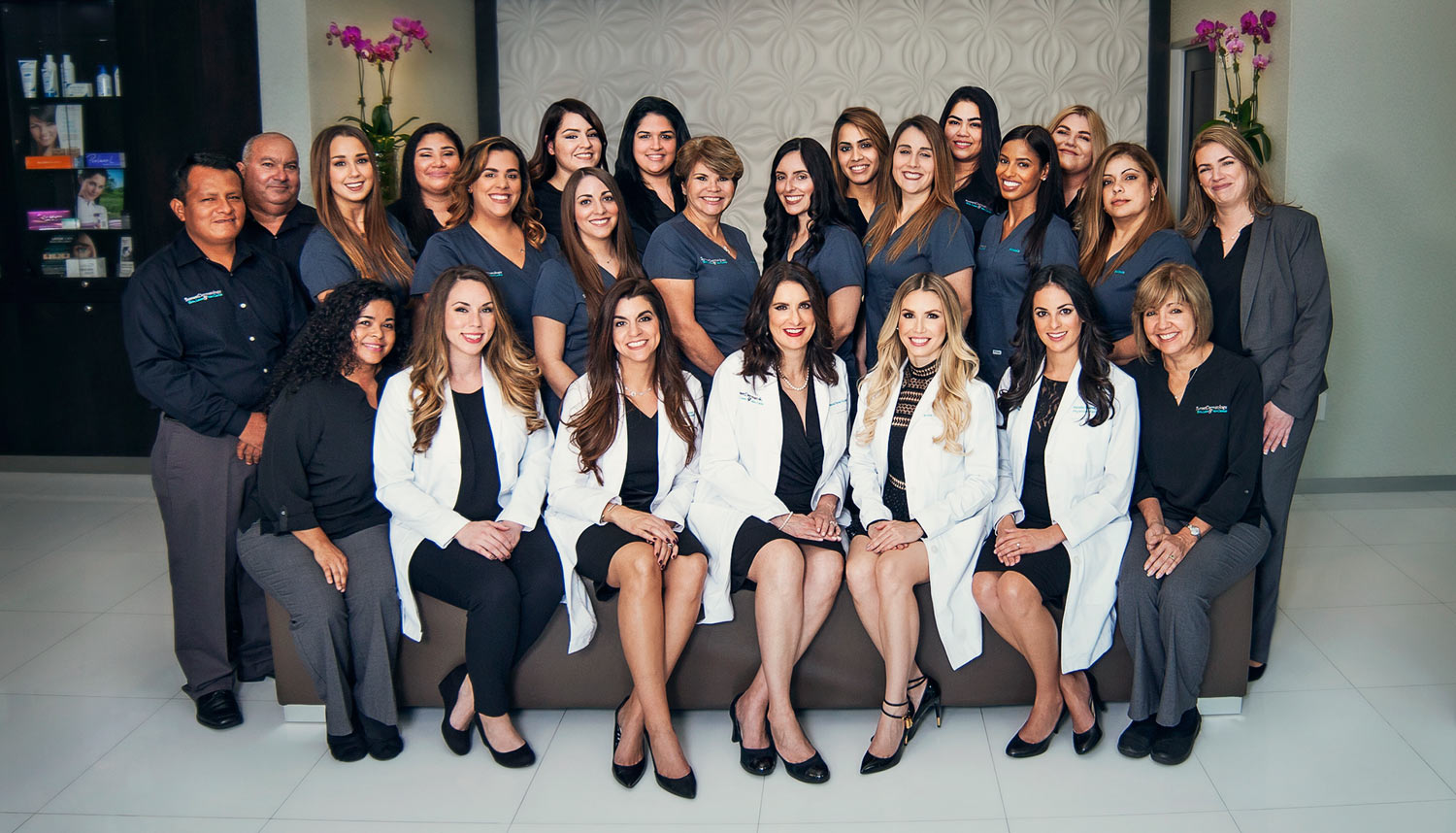 Group picture for providers and staff members of Sunset Dermatology taken at its location on South Miami.