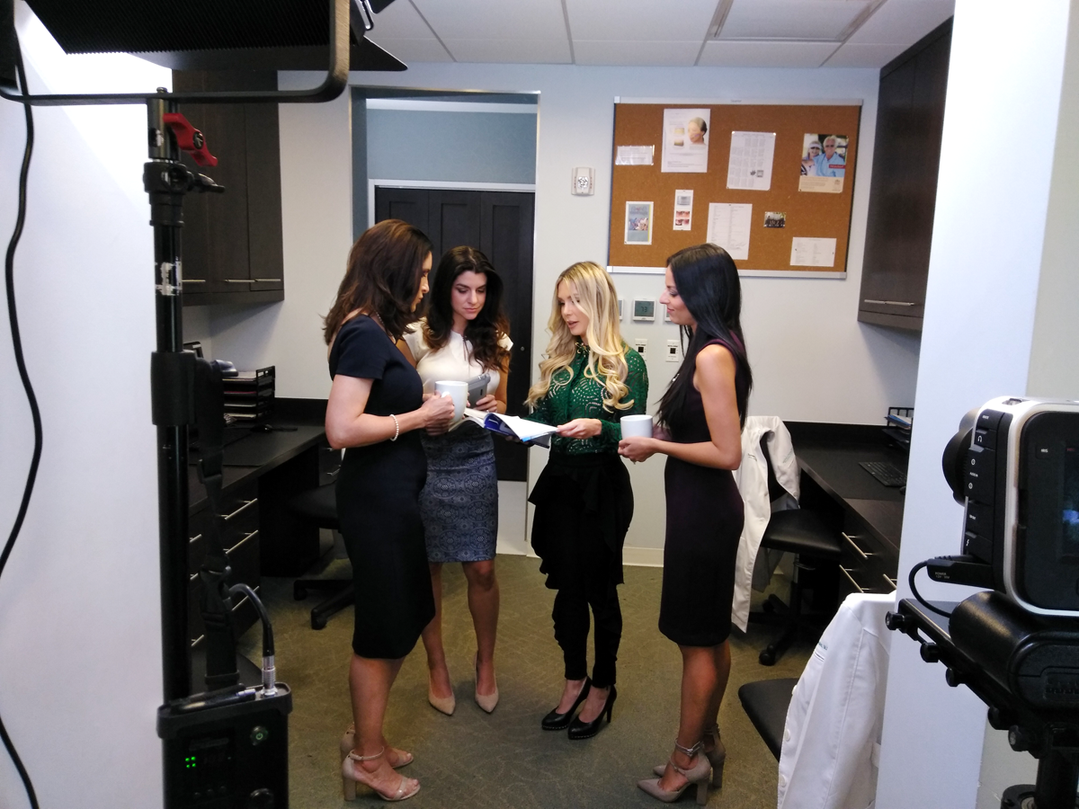Sunset Dermatology providers and staff meeting scene during the filming of the promotional video.