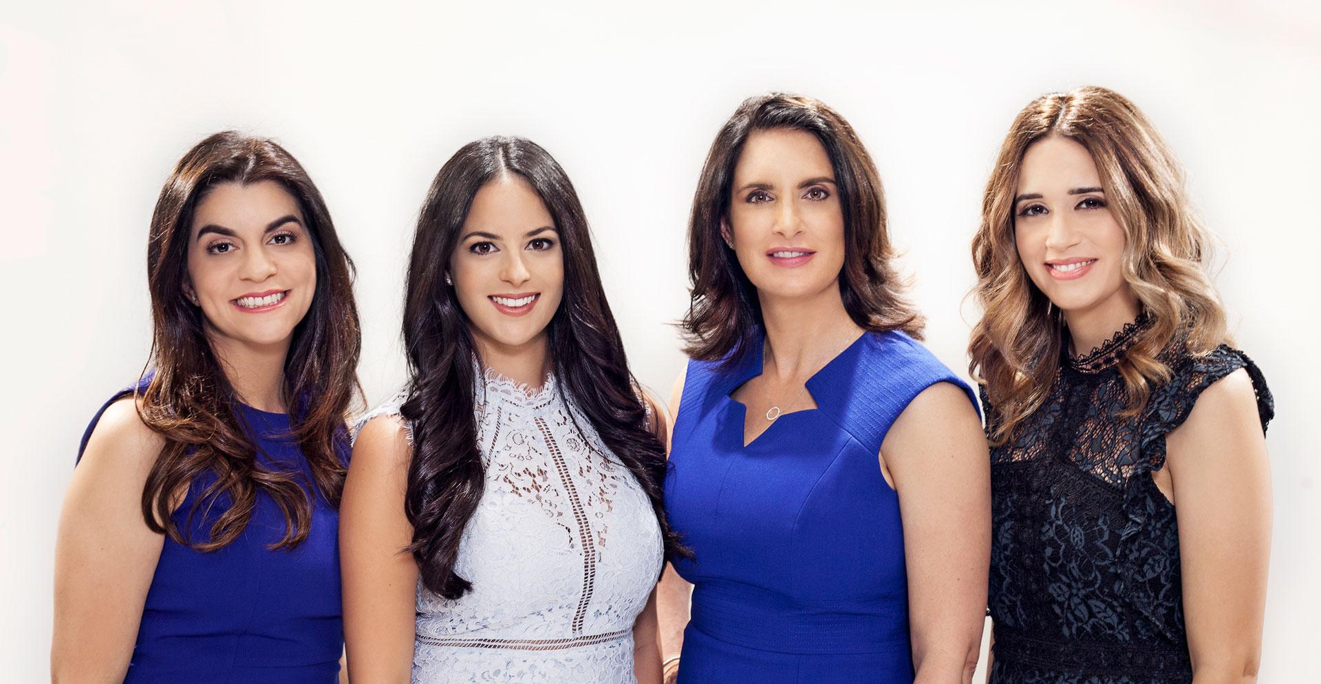 Dr. Ileana Perez-Quintairos and team photo taken at Sunset Dermatology in South Miami.