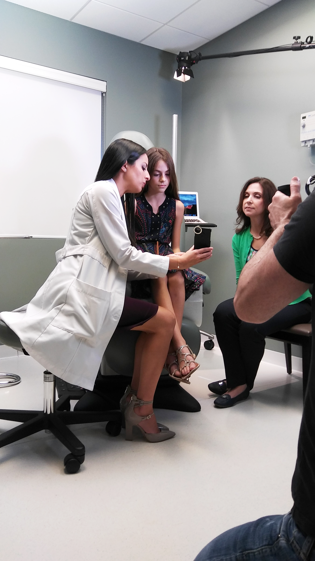 Patient & provider scene photo while performing for the new promotional video at Sunset Dermatology.