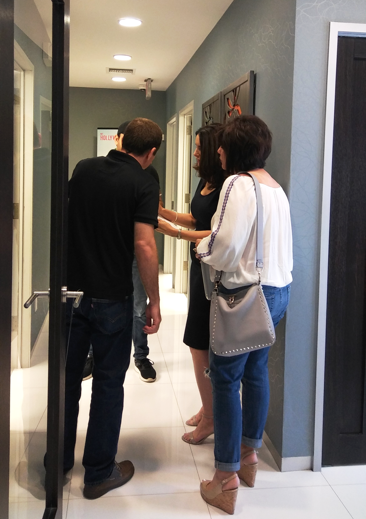 Redmonkie® staff with provider and talent quick meeting before starting filming one of the scenes on the new promotional video for Sunset Dermatology.