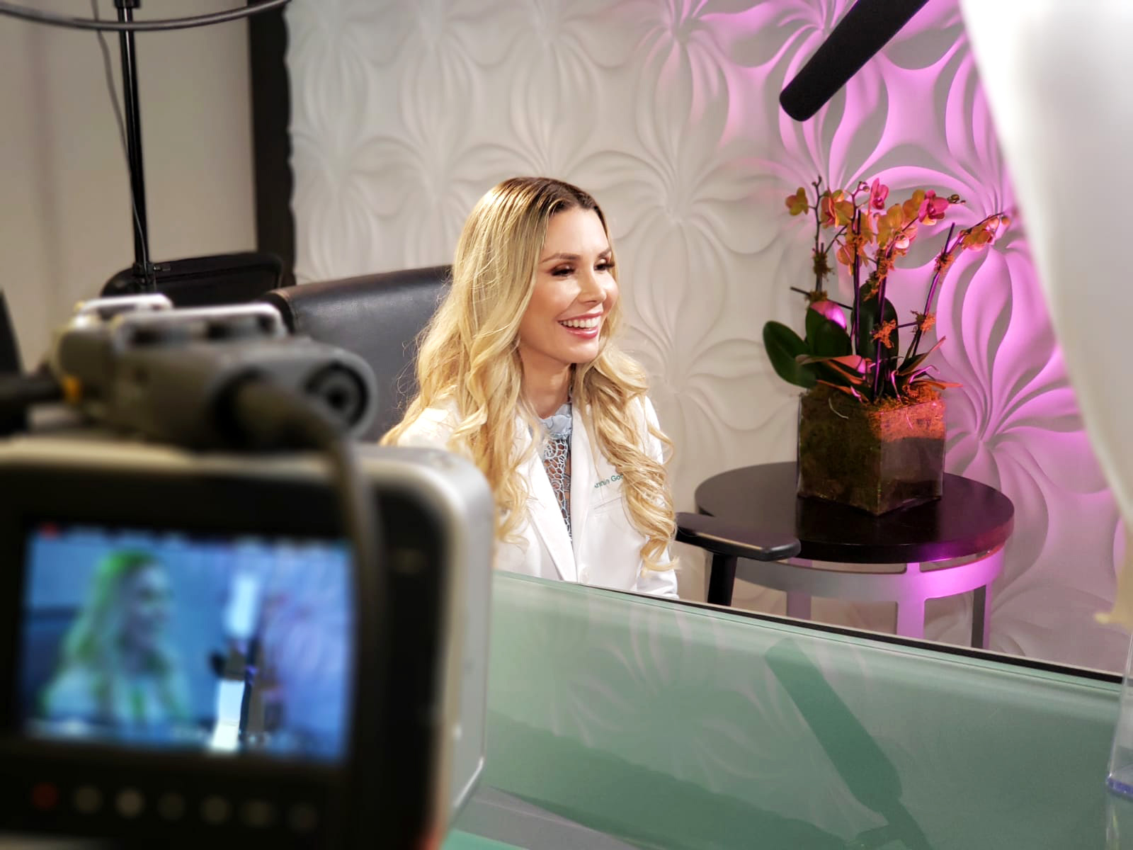 Making cinematography video in a fun way.  Dr. Annie Gonzalez during interview for Botox®, Dysport® and Xeomin® educational video production at Sunset Dermatology.