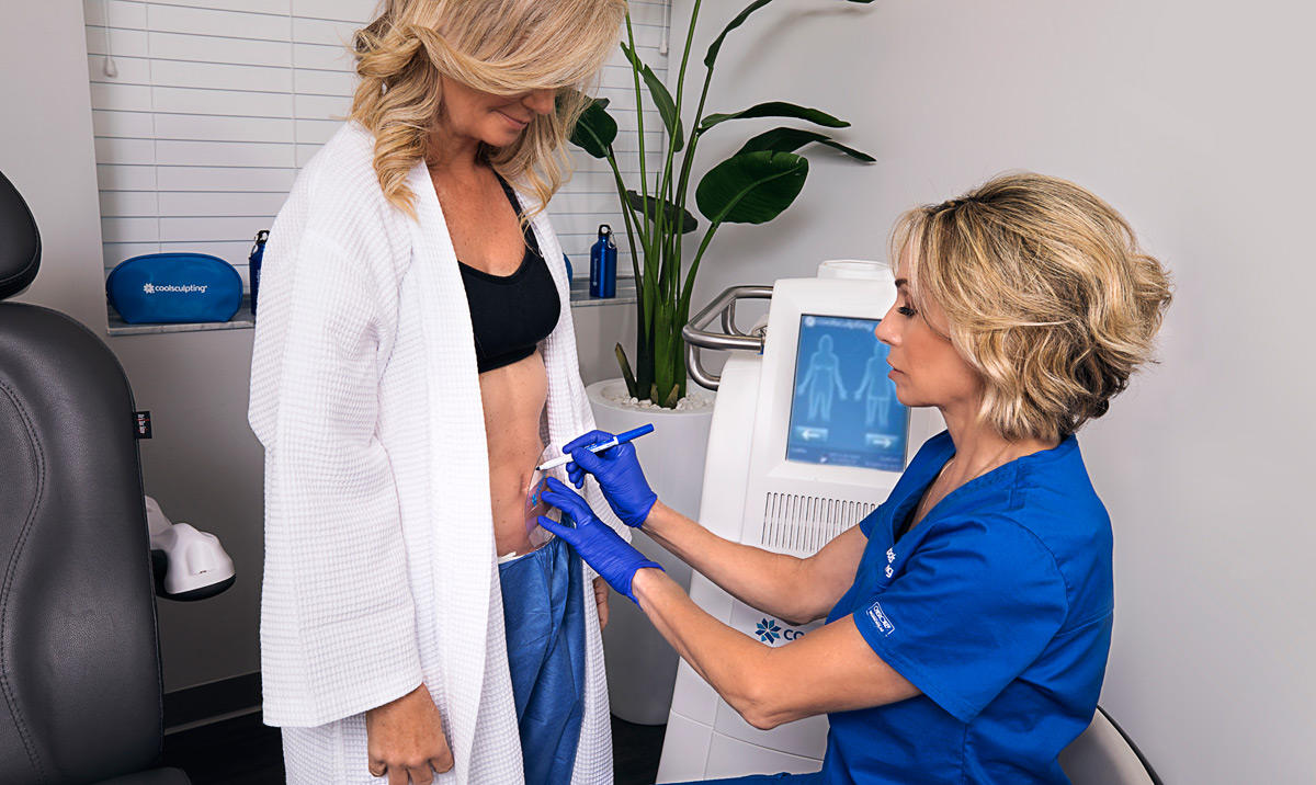 Ruth Bayer, aesthetics specialist, prepares patient for CoolSculpting treatment for Riverchase Dermatology in Miami, FL.