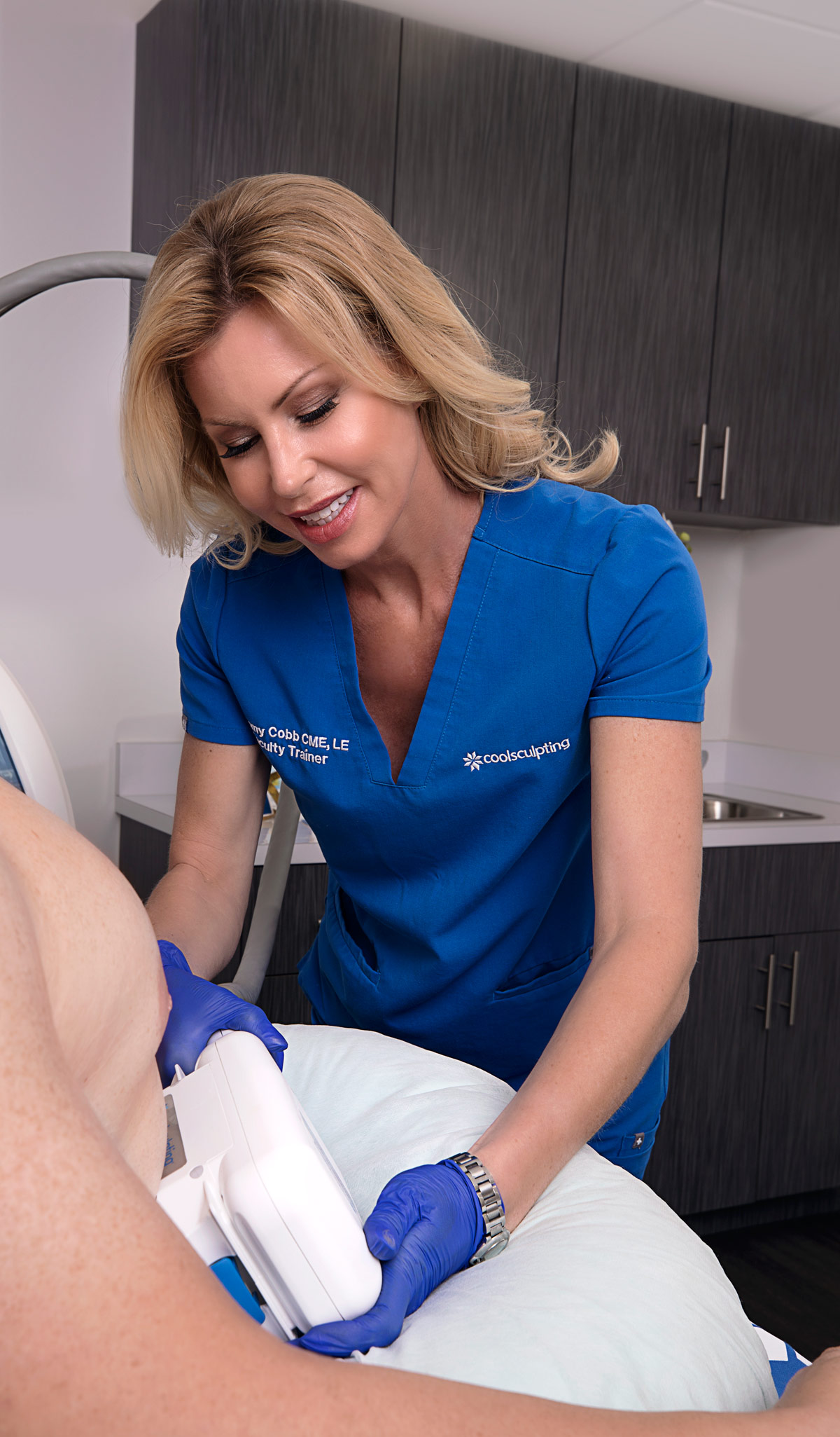 Tammy Cobb, aesthetics specialist, performing CoolSculpting to patient at Riverchase Dermatology in Miami, FL.