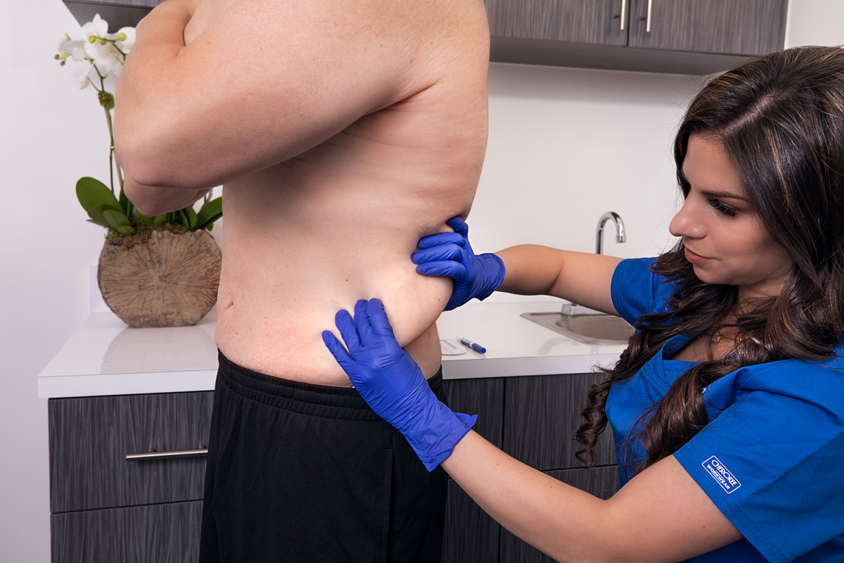 Carla Homez, C.M.A. performing CoolSculpting treatment at Riverchase Dermatology in Miami, FL.