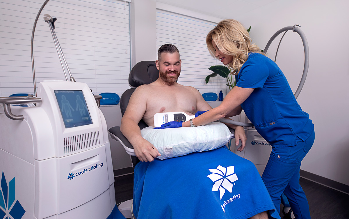 CoolSculpting patient during treatment at Riverchase Dermatology in Miami, FL.