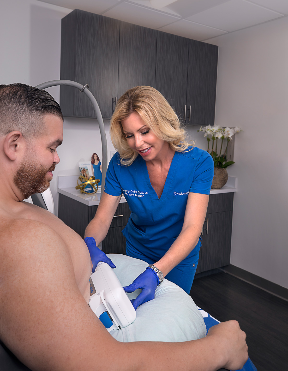 Tammy Cobb, aesthetics specialist, performing CoolSculpting treatment for patient at Riverchase Dermatology in Miami, FL.