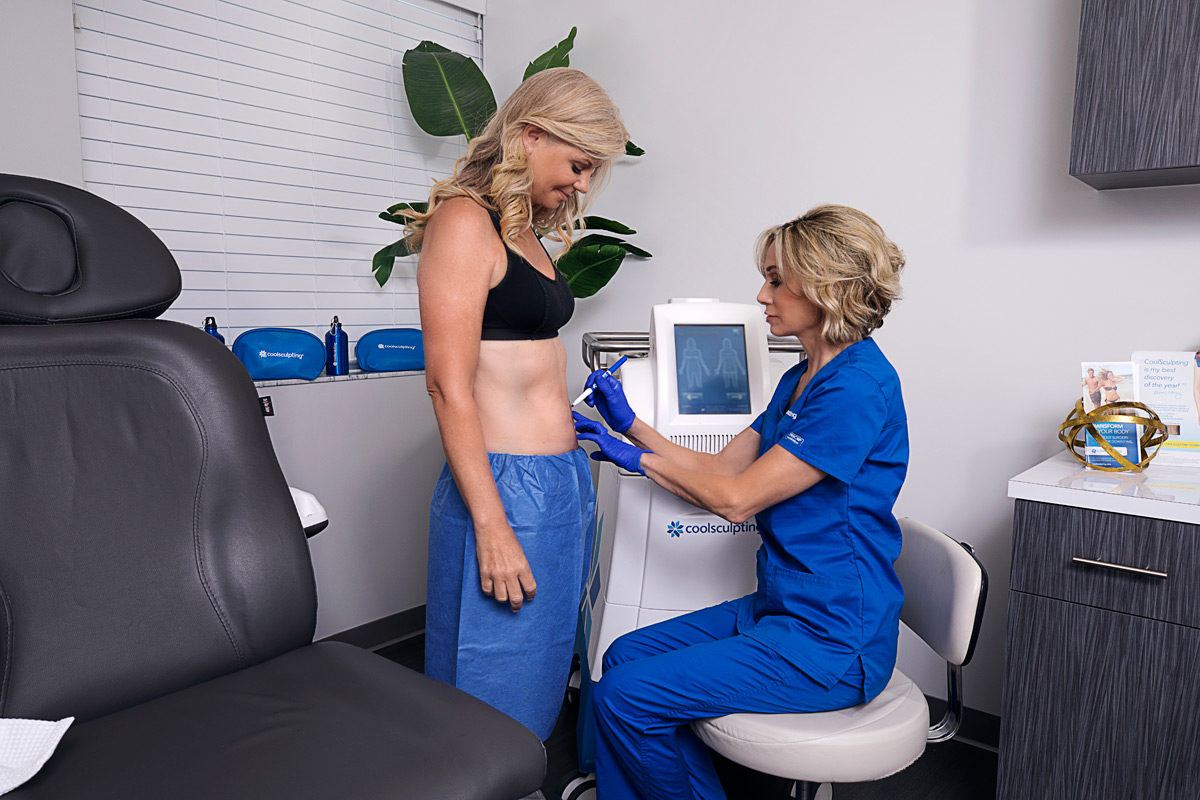 Ruth Bayer, aesthetics specialist, prepares patient for CoolSculpting treatment at Riverchase Dermatology in Miami, FL.