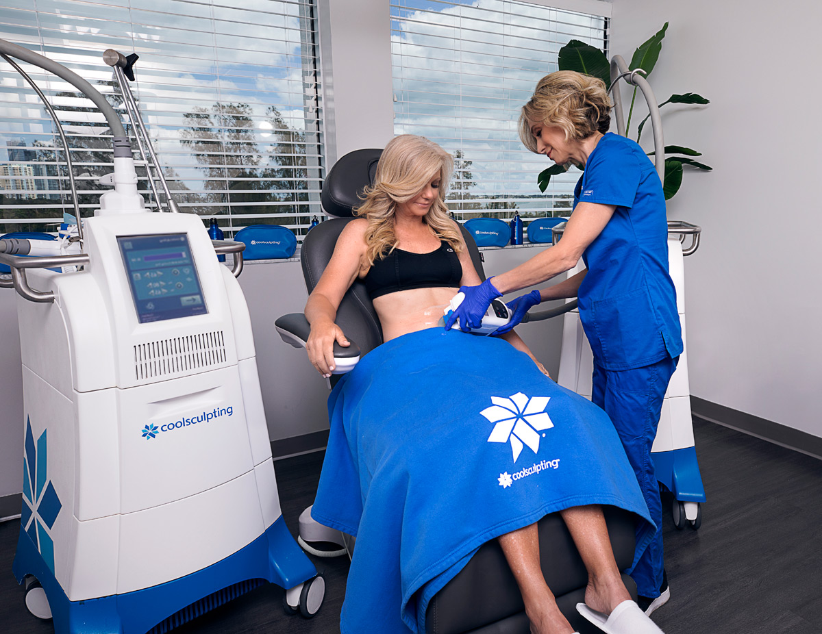 Ruth Bayer, aesthetics specialist, performing CoolSculpting treatment to patient at Riverchase Dermatology in Miami, FL.